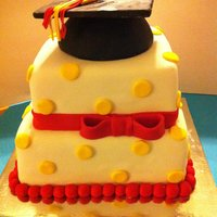"Graduation 10' Choc with whipped choc creme filling8"" vanilla bean with fresh raspberry buttercream filling covered in fondant with a RKT..."