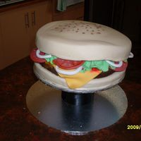Hamburger Cake I made this for my BIL 21st, Boobie cupcakes were placed around tha bottom. All fondant