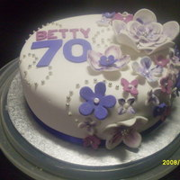 70Th Birthday Cake My first 'floral'cake. My auntie saw a coffee cup design she liked so this is based on that