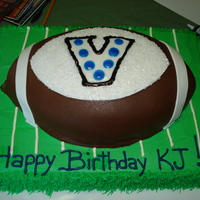 Villanova Football 21St Birthday  Field is Lemon cake with lemon buttercream, Football is lemon cake with dark chocolate fondant with fondant decoration. Logo on football is...