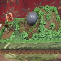 Harry's Indiana Jones Cake Cake for Harry's fourth bday. Indiana Jones figure, pic, and bolder set.