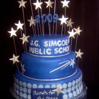 Blue And Silver Grad Cake The first real tiered cake I've done. It's for a grade 6 graduation/farewell. The bottom tier is MESSED up... I've got a...
