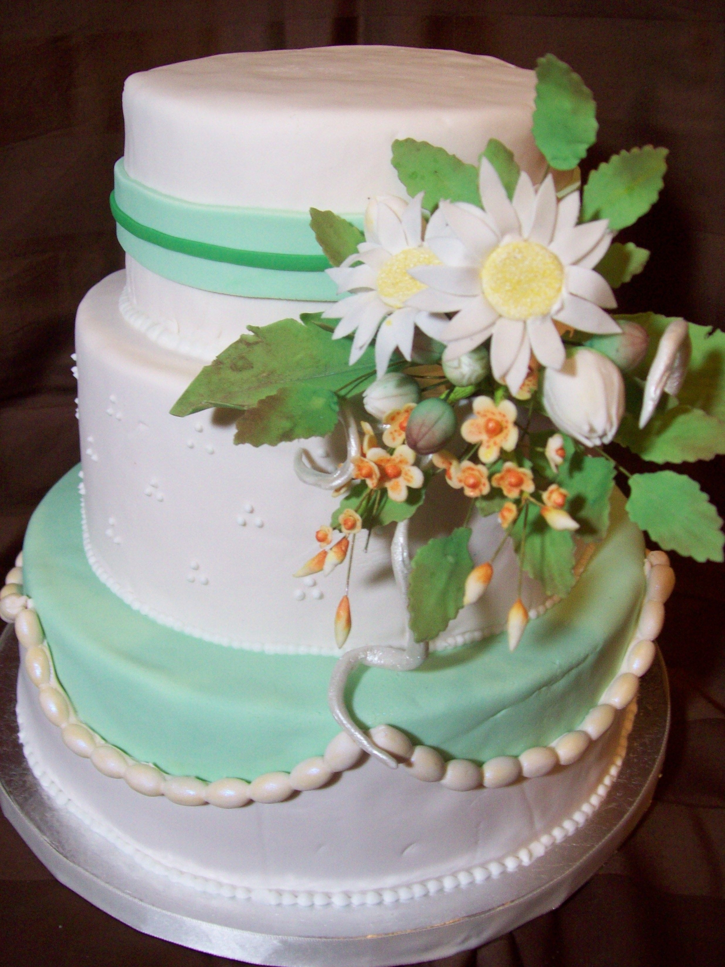 Daisy Wedding Cake The only specifics the customer had for this cake: offwhite, green somewhere (any shade), and maybe daisies. It was fun to play with it. I...