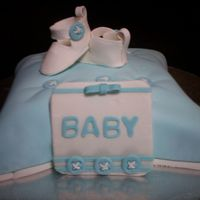 Baby Boy Button Cake  The pillow cake and booties were made using a tutorial and template from CC (i love all you people who help out us newbies with such great...