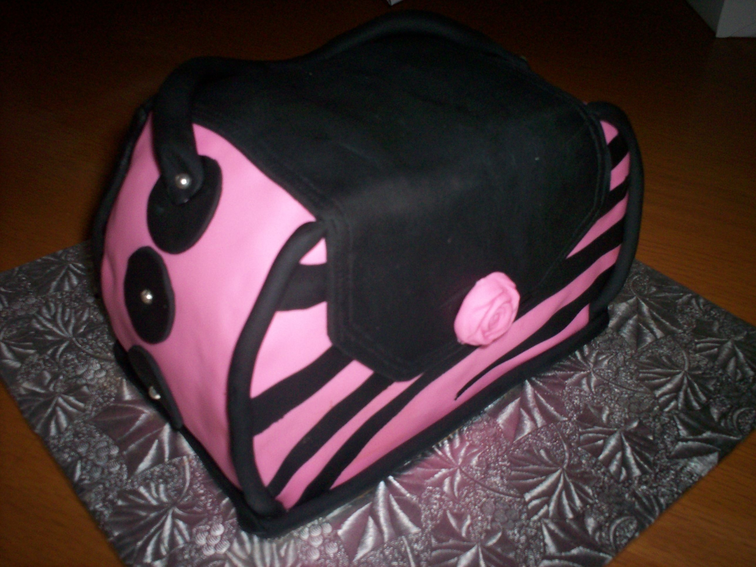 Pink And Black Purse Cake  I made this cake real quick. There was an event and a friend's children's school that I wanted to donate a cake to, but only...