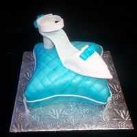 Cinderella Shoe And Pillow Cake The first pillow cake, and first gum paste shoe I`ve done. Wild berry vanilla cake with rose petal buttercream. It didn`t turn out 100%...
