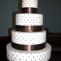 Pink And Brown pale pink fondant with brown dots and ribbon