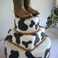 Cowhide With Boot This was a grooms cake i did this last weekend. the boots are made out of milk chocolate and i dusted them with luster dust to give them...