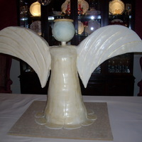 Gold Angel 2 1/2 foot tall angel for charity event. Body is cake and wings and head are styrofoam covered in fondant.