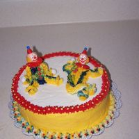 Course 1/cake #2  1st time I've done a clown cake. I really enjoyed making this one. It's a one layer almond with vanilla cream cheese frosting. I...