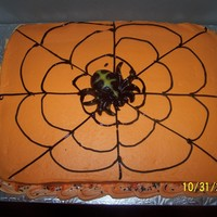 Spider Web Cake  This is a vanilla cake with vanilla/almond BC frosting. I probably should have added a few more straight lines to the web but I'm...