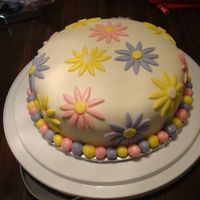 My First Fondant Cake This is my first fondant covered cake. It has a lot of flaws but I think I did a pretty good job of hiding them under the flowers. I'...