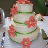 White Wedding Cake   Layered cream cheese frosting with gumpaste orange tiger lilies.