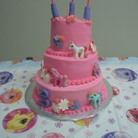My Little Pony   Buttercream frosting with gumpaste flowers and plastic ponies.