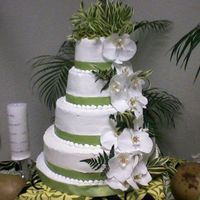 My First Wedding Cake Here is a picture of my very first wedding cake ever created. It is a four tier cake frosted in buttercream. The flowers and foliage are...