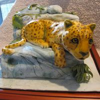 Knightville Elementry School Jaguar This was made for a school auction to raise funds for books. It is fondant covered pound cake painted to look like rocks with vines. The...