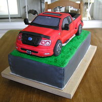 F-150 Pick-Up Truck Groom's Cake This was the second attempt at a vehicle( after I got Mike McCarey's DVD)!! This turned out fine and the groom loved it. It is pound...