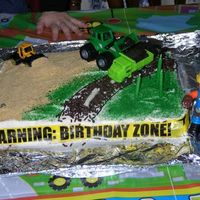 Construction Cake I made this for my son's 3rd birthday. I used crushed graham crackers for the sand, crushed oreos for the dirt that is being put into...