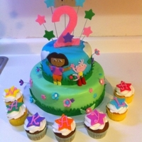 "Dora The Explorer Hi,This cake is a 10"" vanilla cake with strawberry filling and 6"" chocolate wasc with strawberry filling. MMF fondant and..."
