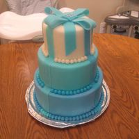 Blue Cake This is a cake dummy I decorated inspired by one I saw on the internet. I covered the dummy with frosting first which was a mistake. I...
