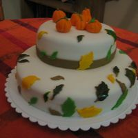 My First Cake, Fall Themed  This is the first cake I ever attempted. I haven't had any classes so this is basically me winging it. Obviously I chose a safe design...