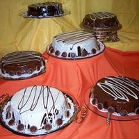 Mud Cakes For Thanksgiving   These are carmel mud cakes and white chocolate mud cakes covered with ganache.