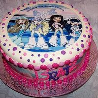 Bratz Winter Birthday   This is simply an edible image of the Bratz. Royal icing dots and M&Ms around the sides.