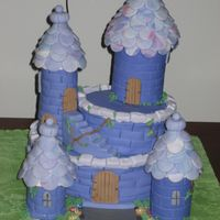 Castle The towers were made out of chocolate cake and the tiles are marble fondant.This cake was my first major cake that I made for nieces 9th...