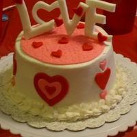 Love Small 6 inch I made for a Valentine's Day Party. Fondant decorations, buttercream icing and border. TFL