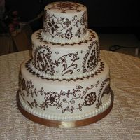 Mehndi Wedding Cake Traditional white cake with mango curd filling and mango infused buttercream icing. The decoration on the cake was inspired by Mehndi (...