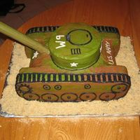 Army Tank Cake Chocolate and Chocolate Chip cakes with vanilla and chocolate buttercream icing. The 'gun' is a cardboard roll covered in...