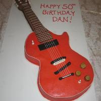 Electric Guitar Devil's Food Cake covered in buttercream with fondant accents.