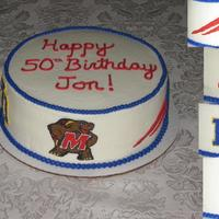 Sports Fan! This was made for a true sports fan! All buttercream icing and freehand piping of mascots.