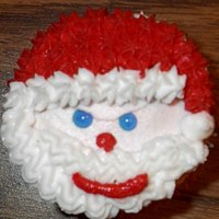 Evil Santa! I know I already posted the Santa cupcakes, but I just had to post this one. I accidentally made an Evil Santa. I didn't even notice...
