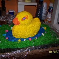 My First 3-D Cake My first 3-d cake. Easter duck sitting in a egg shaped pond, with chewing gum Ester eggs. Grass is coconut. The head is flat because I...