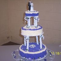 First Wedding Cake I had never done a wedding cake. I done this this one for my sister's wedding, decorated the towers and alll. The color is lavender...