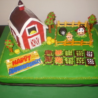 Farmville Anniversary Cake This is a Farmville cake requested for an anniversary. It's devil's food covered in fondant with fondant animals