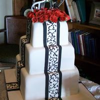 Black & White Wedding My first wedding cake. Made it for my cousin and they wanted B&W scrolling on it. I practiced and practiced hand piping scrolling. I...