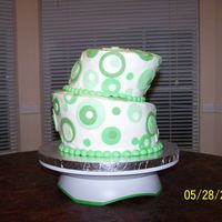 Green Topsy Turvy Graduation cake. This was my first attempt at carving a topsy turvy. I was so intimidated by the idea of cutting it, but I'm glad I...