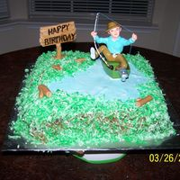 Cakes_035.jpg My friend wanted a German Chocolate cake with coconut for her husband and she wanted it to incorperate fishing. So its a fondant pond,...