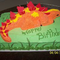 "3D Dinosaur sheet cake with 9"" round cut and assembled to be dinosaur. All BC with fondant accents. took the toothpics out when it got to the B-..."