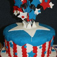 "4Th Of July 10"" round carved to tapper slightly, all covered in fondant. Red Velvet and French Vanilla with blue colored BC."