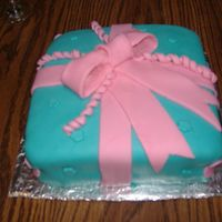 Birthday Present Cake My 2nd birthday present cake. Coconut w/ coconut filling. TFL:)