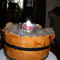 Wooden Beer Barrel This was my first try at a beer barrel cake.I used unflavored gelatin refrigerated in ice cube trays for the ice cubes. Fondant wood panels...