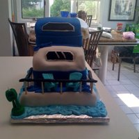 House Boat Make for a surprise 50th and designed after the birthday boys house boat. The main accessory for this family were the teal aderondak chairs...