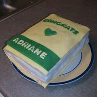 Nursing Book  This is for my sister's graduation. She's a nurse in the NICU in TX. The cake is yellow with chocolate icing and covered in...