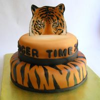 Tiger Time This was done for and end of year thank you for a school principle. Its white fondant with airbrushed color and hand painted tiger stripes...