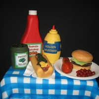 "Birthday Bbq Half Sheet Cake covered with fondant ""tablecloth"". Condiments & chicken are rice cereal treats, plate is gumpaste, burger and..."