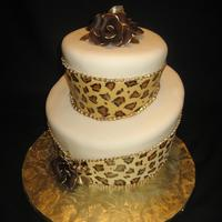 Leopard Print Topsy Turvy Handpainted leopard print with modeling chocolate roses and edible gold.