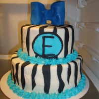 Blue Zebra this was a replaca of another cake i did (it was pink and zebra).marble cake with buttercream and fondant accents